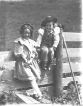 Image of Children on a Fence