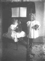 Image of Loewe and Friend With Instruments - P2002.14.154