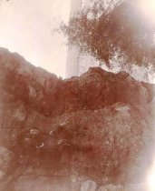 Image of M. Rice posing on a rock - P2004.35.70