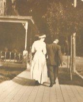 Image of Couple Walking on a Boardwalk