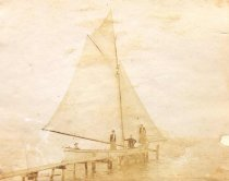 Image of Group in a Sailboat at Dock - P2005.72.4