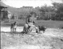 Image of Mary Bruehl Feeding the Pets - P2002.14.553