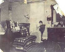 Image of Woman in Bedroom - P2011.21.53