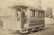 Image of Charles Baumgartner driving an Oshkosh Streetcar