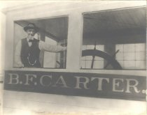 """Image of Herman Hitz in Pilot House of the """"B.F. Carter"""" - P1999.46.3"""