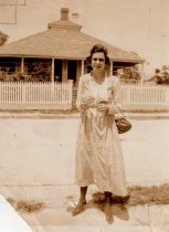 Image of 0000.00.0027b - Claudia Demeritt Moore in Front of House