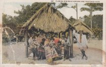 Image of Florida Seminole Indians and Thatched Huts