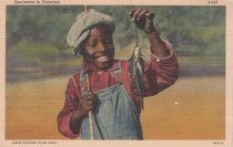 Image of Young boy with fish