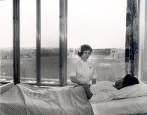 Image of Nurse with Patient in University Hospital Room overlooking stadium