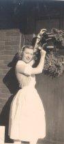 Image of Nurse hanging wreath