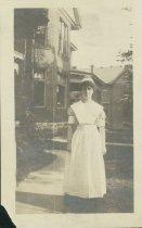 Image of Nora Ellen Turner, modeling 1917 student nurse uniform