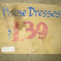 "Image of Sign - Sign ""House Dresses, $1.39"""