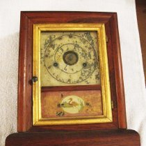 Image of Seth Thomas shelf clock, mahogany case, spring driven, glass door has bold frame, painting of flamingo at lower part, face deteriorated - Museum Collection