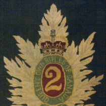 Image of Officers' Mess Carpet close up of crest woven in centre