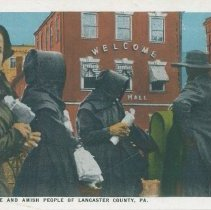 Image of Mennonite and Amish People of Lancaster County, Pa. - A group of Amish men and women standing on a city sidewalk holding baskets and other goods. Reproduction of 1984.001.0150, 1984.001.0152, 1984.001.0153, 1984.001.0154, 1984.001.0155, 1984.001.0156, 1984.001.0157, 1984.001.0160, 1984.001.0161, 1984.001.0162, 1984.001.0163, 1984.001.0164, 1984.001.0165, 1984.001.0166, 1984.001.0167, 1984.001.0168, 1984.001.0169, 1984.001.0170, 1984.001.0171, 1984.001.0172, 1984.001.0173, 1984.001.0174, 1984.001.0175, 1984.001.0176 Commercialchrome