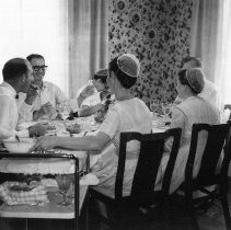Image of Sunday Dinner at John and Darlis Myers', Oct. 8, 1961 - Wilbur and Romaine Miller, Elton and Rosa Moshier, and John and Darlis Myer, eating at the table. Part of a photograph album titled: Bart Mennonite Church, 1962-1969