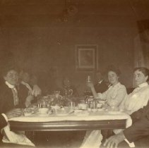 Image of Emma Barton Coombs at a dinner party