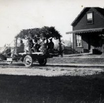 "Image of Parade Car Passing By the ""Red House"" on Ukiah St., Mendocino, CA"