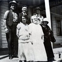 Image of Daubenek Family and friends, on steps of Central Hotel, Mendocino