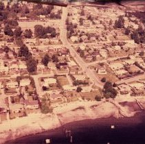 Image of Dollarton, looking West up Dollar Rd - Aerial shot looknig west up dollar rd. Rows of housing, beach and ocean