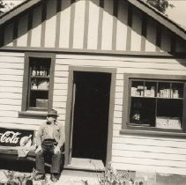 Image of 0267 - John Moore Sr in front of store