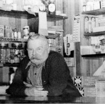 Image of 0109 - John Moore in his store