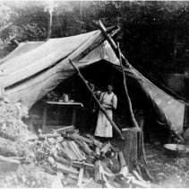 Image of 0116 - Young man in front of cook's tent