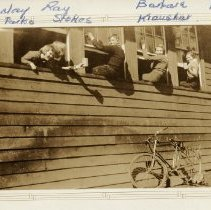 Image of Students cleaning windows at Roche Point School - 0148 - Roche Point School, students cleaning windows.   3 of the 5 students are sitting on windows still looking at camera with heads turned to camera. Two girls in front window lean out of the first window. Bike rests against building,