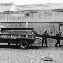 Image of 0424 - District workers unloading Dollar Mill bench 1986