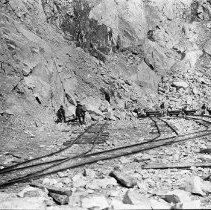 Image of 0731 - Granite Quarries men piling rocks on flatbed