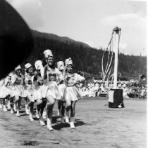 Image of Majorettes on baseball field                                                                                                                                                                                                                                   - 1080 - Majorettes on baseball field