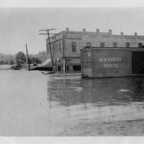 Image of Elkin Flood - Elkin flood of 1916.  A flooded Southern freight car is in the foreground, and a flooded brick building is in the background.  It is a copy from the North Carolina Collection at the UNC Library in Chapel Hill.