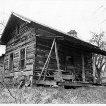 Image of Hickman House - Hardin Hickman house, on the outskirts of White Plains, probably built during the 3rd quarter of the 19th century.  It is a log structure in deteriorating condition.