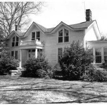 Image of Freeman House - Alex Freeman House, located at 321 S. Main St., Dobson.  According to information in SIMPLE TREASURES, the house was begun prior to the Civil War but not completed until the post-war years.  As of 1987, it was still owned by the Freeman family.  State Record 487.