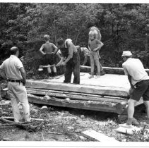 Image of Pickshin Park - Pickshin Park.  Picture of men and boys at work on the construction of a new cabin at Pickshin Park.