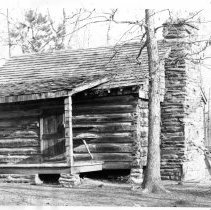 "Image of Pickshin Park - Pickshin Park, log cabin.  Note on the back of the picture reads, ""The old cave cabin at Pickshin Park was moved from Cave's Mill Road.  It was built in 1874."""