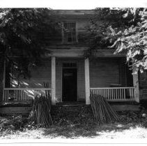 Image of Dobson House - Porch of the John Hughes Dobson House located on SR 2230 in the Rockford vicinity.  According to information in SIMPLE TREASURES, members of the Dobson family lived for more than a century in the house, which was built in 1856.