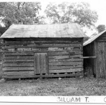 Image of Log Structure - Single-pen log structure immediately behind a one-story frame house which family tradition associates with Henry Crissman.  It is located on SR 2080 in the Siloam Township.  Its history and date of construction are not known.  State Record 176.