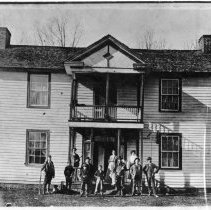 "Image of Westfield Academy - Westfield Academy, located at the intersection of Hwy 89 and Pilot-Westfield Road.  According to notes on the back of the picture, it was organized in 1892, incorporated into the house which was built in 1884.  Notes also refer to it as ""Westfield School or Academy.""  Several people are standing in front of the building, three of the men holding rifles."