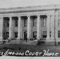 "Image of Court House - Old Court House in Dobson.  Notation on the front says, ""Dobson's $100,000 Court House.""  On the back are written the names ""Mrs. Carter"" and ""Minick.""  In the bottom left-hand corner, the number 1 is circled."