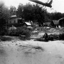 Image of Kapp's Mill - Kapp's Mill, picture taken from across the Mitchell River.  Several men, horses, wagons, and livestock are in the background.