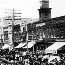 Image of Main Street, Mount Airy - Main Street Mount Airy, looking north.  The street is crowded with people, covered wagons, and numerous people are leaning out of second story windows.