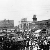 Image of Main Street, Mount Airy - Main Street, Mount Airy, looking north from Franklin Street.  The street is crowded with people, whose attaire seems to date the period to early 1900s.  Jarvis Wholesale Groceries, Dry Goods & Notions is in the foreground.