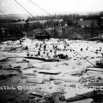 Image of Granite Quarry - Mount Airy Granite Quarry, general quarry view.  Several men can be seen working.