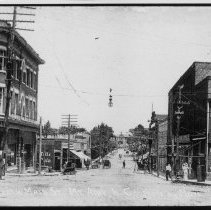 Image of North Main Street, Mount Airy - North Main Street, Mount Airy, looking north from Blue Ridge Hotel.  W. E. Merritt Building on left, several horse-drawn vehicles in the street.