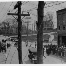 Image of Mount Airy, Looking South - Mount Airy looking south, corner S. Main and W. Pine around 1923.  In the picture are automobiles, horse and buggy, a number of people on foot, residential buildings in background.