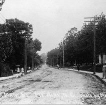 Image of Mount Airy, Looking South - Mount Airy Main Street looking south.  Presbyterian Church, built 1914, on right.  Girls are standing on sidewalks.