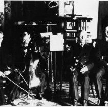"Image of The Woodruff Brothers - The Woodruff Brothers, musical group.  Left to right, ""Mr. Tom"" ""Mr. George"" ""Mr. Frank"" and Dick McGargo.  Gentlemen are seated with their musical instruments."