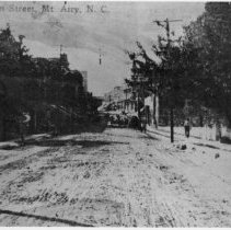 Image of North Main Street, Mount Airy - North Main Street, Mount Airy, looking north from Franklin Street.  The street has not yet been paved.