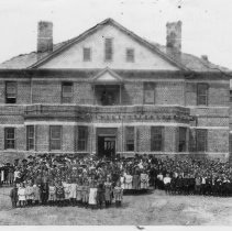 Image of Rockford Street School - Rockford Street School, Mount Airy.  Student body is gathered outside the school for a group picture.  Early 1900s.